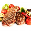 Grilled Beef Steak with Vegetables over White Background  — 图库照片
