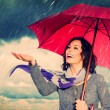 Smiling Woman with Umbrella over Autumn Rain Background — Stockfoto #36297379