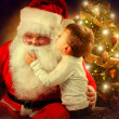 Santa Claus and Little Boy. Christmas Scene — Stock Photo