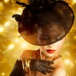 Glamour Woman Portrait over Holiday Golden Background — Stock Photo