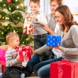 Christmas Family. Children Opening Gifts. Christmas tree — Stock Photo #36297763