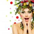 Stock Photo: Christmas Woman. Christmas Tree Holiday Hairstyle and Make up