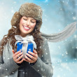Beautiful Young Woman with Christmas Gift Box. Surprised Girl  — ストック写真