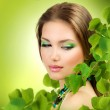 Beautiful Girl with Green Leaves. Spring Beauty outdoor — Stock Photo