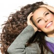 Beauty Woman with Long Curly Hair. Healthy Blowing Hair — Stock Photo