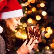 Christmas Gift. Happy Surprised Woman opening Giftbox — Stock Photo