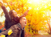 Happy Couple in Autumn Park. Fall. Family Having Fun Outdoors — Stock Photo