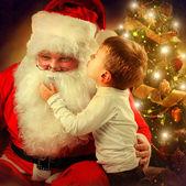 Santa Claus and Little Boy. Christmas Scene — Stock Photo
