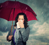 Sneezing Woman with Umbrella over Autumn Rain Background — Stock Photo