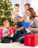 Christmas Family. Children Opening Gifts. Christmas tree — Stock Photo