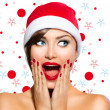 Christmas Woman. Beauty Model Girl in Santa Hat — Stock Photo