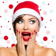 Stock Photo: Christmas Woman. Beauty Model Girl in Santa Hat