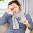 Stock Photo: Sick Womwith Thermometer. Flu. WomCaught Cold
