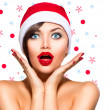 Christmas Woman. Beauty Model Girl in Santa Hat — Stock fotografie