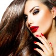 Stock Photo: Sexy Beauty Girl with Red Lips and Nails. Provocative Makeup