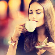Stock Photo: Coffee. Beautiful Girl Drinking Tea or Coffee