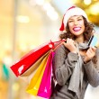 Christmas Shopping. Girl With Credit Card In Shopping Mall — Stock Photo #36962837