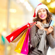 Christmas Shopping. Girl With Credit Card In Shopping Mall — Stock Photo