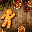 Christmas Holiday Background. Gingerbread Man over Wood — Stock Photo #36962909