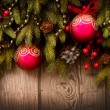 Photo: Christmas Tree and Decorations Over Wooden Background