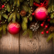 Christmas Tree and Decorations Over Wooden Background — Stok fotoğraf