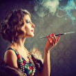 Stock Photo: Retro WomPortrait. Smoking Lady with Mouthpiece