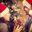 Christmas Happy Couple with Christmas Gift at Home — Stock Photo