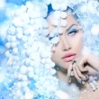 Stock Photo: Winter Beauty. Beautiful Fashion Model Girl with Snow Hair style