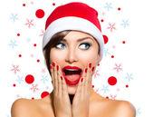 Christmas Woman. Beauty Model Girl in Santa Hat — Stock Photo