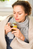 Sick Woman with Hot Drink. Headache. Flu — Stock Photo