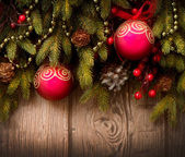 Christmas Tree and Decorations Over Wooden Background — Stockfoto
