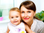 Mother and Baby kissing and hugging at Home — Stock Photo