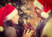 Christmas Happy Couple with Christmas Gift at Home — Foto Stock