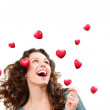 Beauty Young Woman Catching Valentine Hearts. Love Concept — Stock Photo #40234783