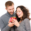 Valentine Gift. Happy Young Couple with Valentine's Day Present — Stock Photo #40234789