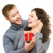 Valentine Gift. Happy Young Couple with Valentine's Day Present — Stock Photo #40234867
