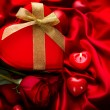 Valentine Red Hear Gift and Red Rose Flower over Red Silk — Photo #40234925