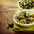 Stock Photo: Capers Closeup on Wooden Table
