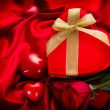 Valentine Red Hear Gift on Red Silk Background — Stock Photo #40235035