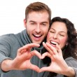 Stock Photo: Valentine Couple Making Shape of Heart by their Hands