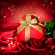 Valentine Red Hear Gift and Red Rose Flower over Red Silk — Stockfoto
