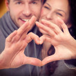 Valentine Couple Making Shape of Heart by their Hands — Stock Photo #40235403