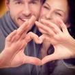 Valentine Couple Making Shape of Heart by their Hands — Stock Photo