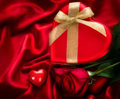 Valentine Red Hear Gift on Red Silk Background — Stock Photo