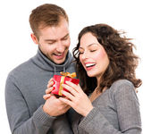 Valentine Gift. Happy Young Couple with Valentine's Day Present — Stock Photo
