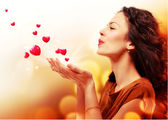 Woman Blowing Hearts from her Hands. St. Valentines Day Concept — Stock Photo
