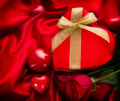Valentine Red Hear Gift on Red Silk Background — Stock Photo