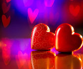 Couple of Valentines Red Hearts over Abstract Purple Background — Stock Photo