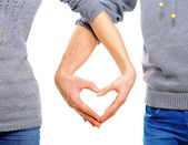 Valentine Couple in love showing Heart with their fingers — Stock Photo