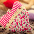 Valentine's Day. Handmade fabric heart over wood background — Stock Photo